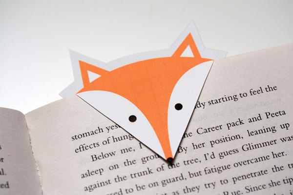 A homemade cardboard bookmark shaped like a fox